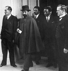 "Haile Selassie clutches evidence of the full support he received from the League of Nations – a '""Sorry you were invaded"" card"